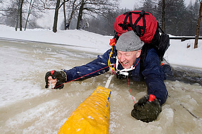 Man in a hole in the ice Sweden. - p5751270f by Fredrik Schlyter