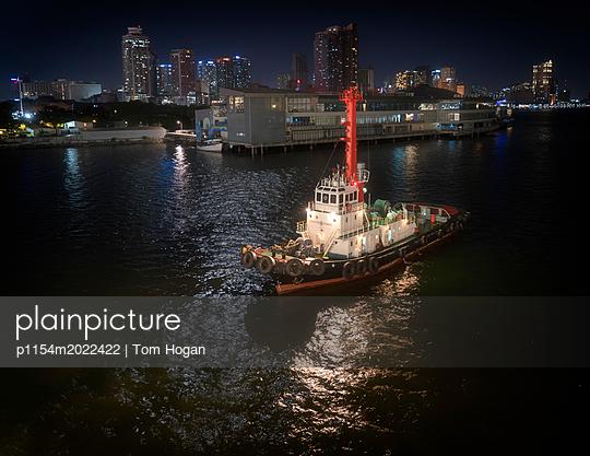 Tug at Midnight - p1154m2022422 by Tom Hogan