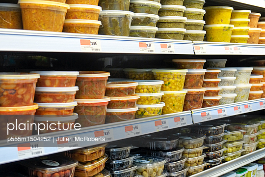 Plastic containers of food on supermarket shelves - p555m1504252 by Julien McRoberts