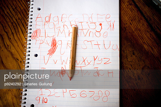 Child's writing on notepad with pencil - p9240292 by Charles Gullung
