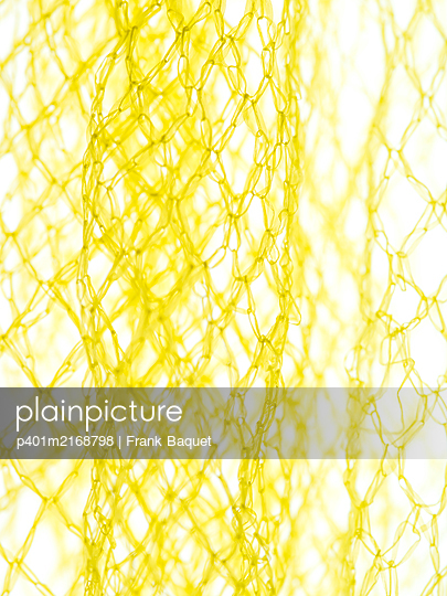 Yellow net packaging - p401m2168798 by Frank Baquet