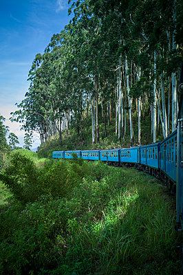 Blue train traveling from Ella to Kandy, Sri Lanka, Asia - p934m1558799 by Sebastien Loffler