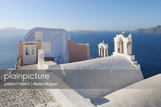 View of Oia village with bell tower of Greek Orthodox Church at Santorini - p300m718967f by Martin Rügner
