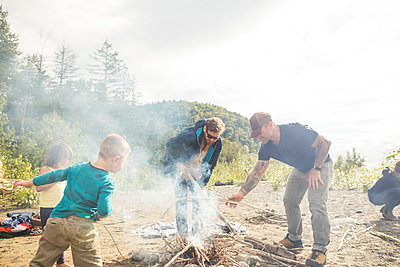 Two men starting campfire - p1166m2202004 by Christopher Kimmel / Alpine Edge Photography