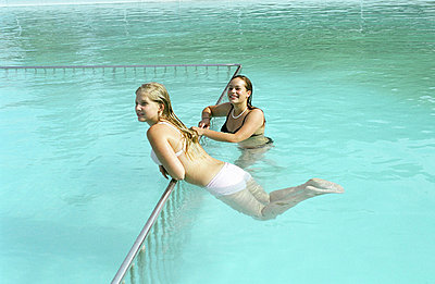 Two girls in a swimming pool - p3590003 by D. Holly