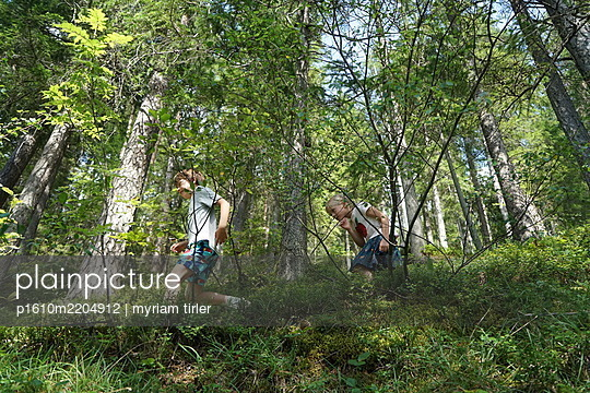 A brother and sister discovering the forest - p1610m2204912 by myriam tirler
