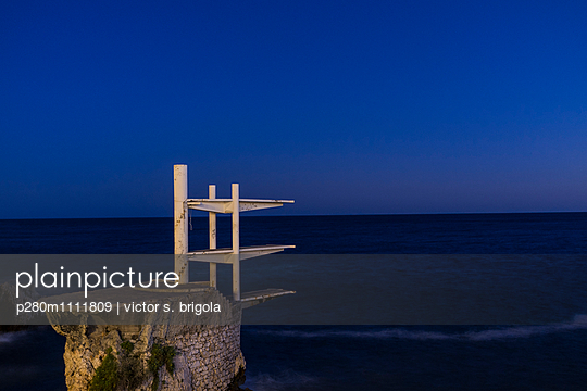 Diving platform on the waterfront at night - p280m1111809 by victor s. brigola