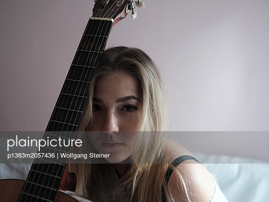 Woman with guitar - p1383m2057436 by Wolfgang Steiner