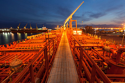 High angle view of deck piping on oil tanker ship - p555m1414142 by Tom Paiva Photography