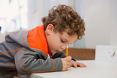 Toddler writing in classroom - p924m1015604f by Kinzie+Riehm