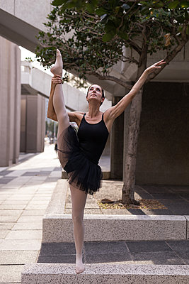Beautiful woman performing ballet in the city - p1315m2014511 by Wavebreak