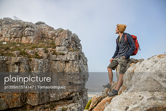Young man on a hiking trip high in the mountains - p1355m1574147 by Tomasrodriguez