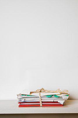 A bundle of letters in worn envelopes, tied with a string of raffia. - p1433m2071760 by Wolf Kettler