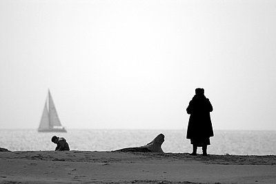 Woman looking at the sea - p8290150 by Régis Domergue