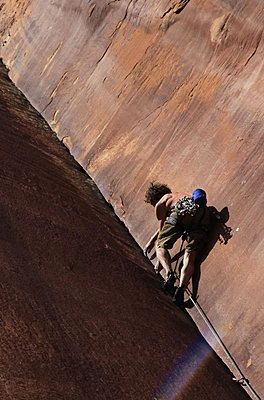 A climber tackles an overhanging corner on the cliffs of Indian Creek, a famous rock climbing area near Moab, Utah, United States of America, North America - p8713162 by David Pickford