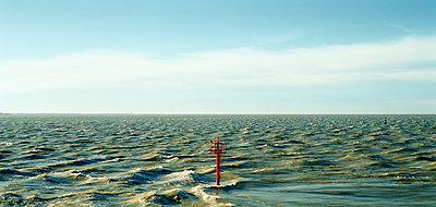Navigation light at sea - p1132m925601 by Mischa Keijser