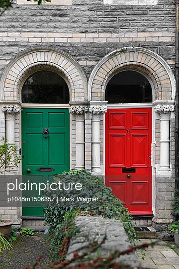 Red and Green Victorian front doors together - p1048m1506357 by Mark Wagner