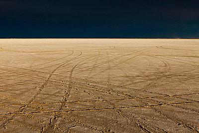 Tire tracks on the Bonneville Salt Flats. Speed Week. A dark stormy sky. - p1100m876031f by Paul Edmondson