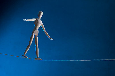 An artist's figure walking a tightrope - p301m730738f by Larry Washburn