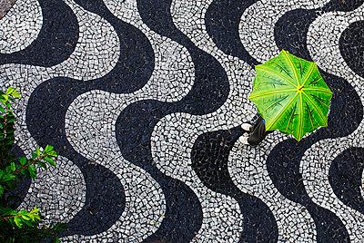 Woman standing under an umbrella, Brazil. - p31224621f by Juliana Wiklund