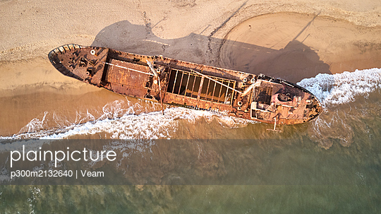 Aerial view of a shipwreck at the beach, Namibe, Africa - p300m2132640 by Veam
