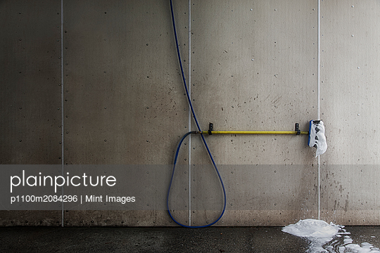 Foaming brush with hose in car wash,Seattle, Washington, USA - p1100m2084296 by Mint Images