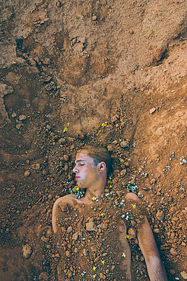 Man Buried in Shallow Grave - p1262m1072842 by Maryanne Gobble