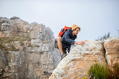 Young man on a hiking trip high in the mountains - p1355m1574146 by Tomasrodriguez