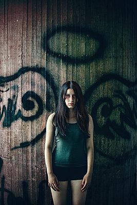 Girl in front of a concrete wall - p1432m2258598 by Svetlana Bekyarova