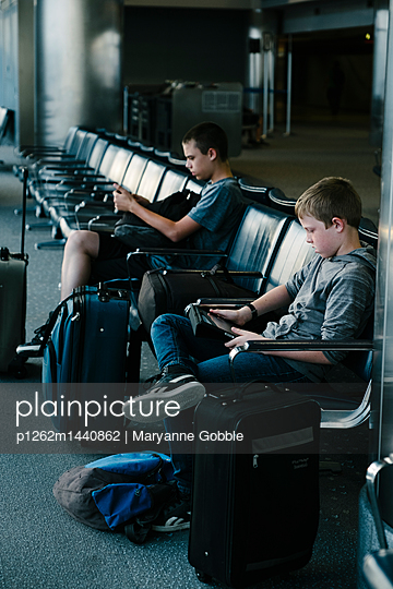 Boys Waiting in Airport - p1262m1440862 by Maryanne Gobble