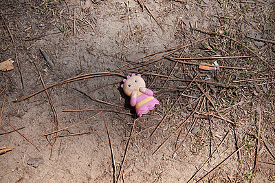 Childs toy laying on dusty ground - p1072m829374 by Neville Mountford-Hoare