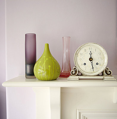 Alarm clock and vases on mantlepiece in Harrogate home - p349m790387 by Brent Darby