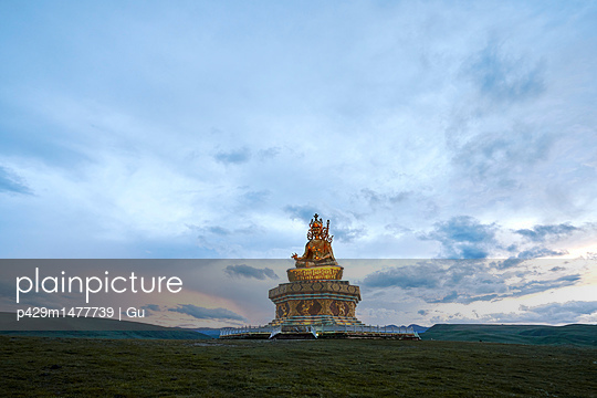 Golden buddhist sculpture on hill, Baiyu, Sichuan, China