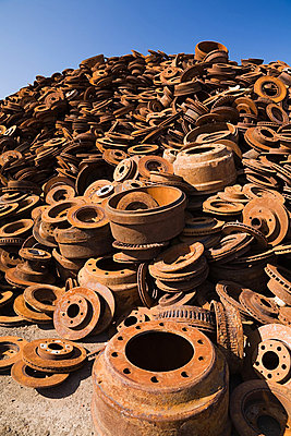 Stack of rusting metal - p9243807f by Image Source