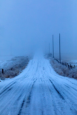 Snow on rural road - p1427m2066921 by Steve Smith