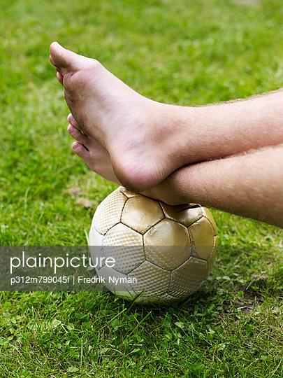 Bare foot on soccer ball