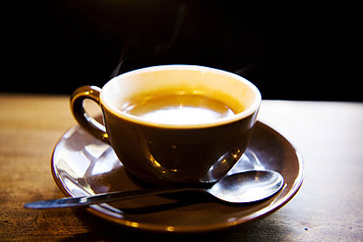 Close-up of a cup of espresso with a spoon on a saucer - p4550617f by GUSK