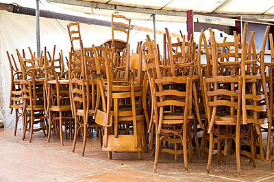 Heap of wooden chairs - p4902870 by Jürg Waldmeier