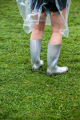 Female legs in silver glitter wellington boots  - p1057m2008598 by Stephen Shepherd