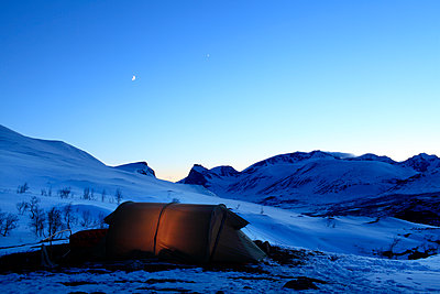 View of tent at evening - p575m1074479f by Fredrik Ludvigsson