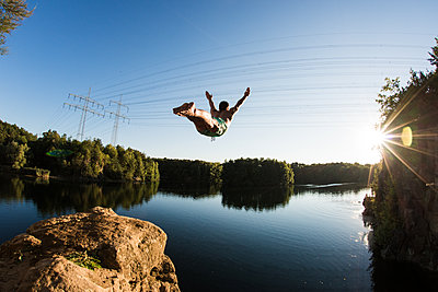 Cliff diver - p1142m1220744 by Runar Lind