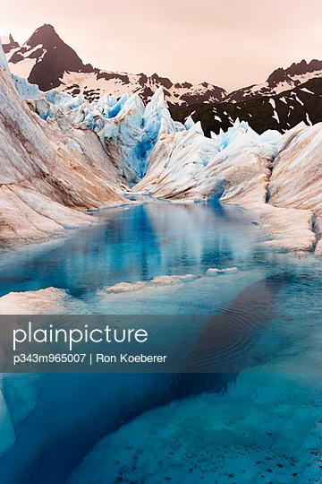 Glacial pond reflection. - p343m965007 by Ron Koeberer