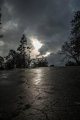 Rain clouds over country road - p1134m1440781 by Pia Grimbühler
