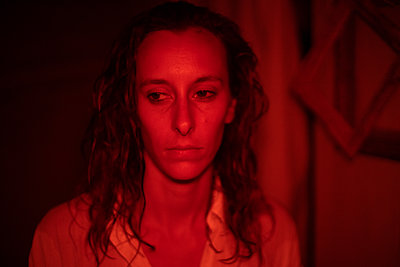 Woman in red licht - p1321m2207416 by Gordon Spooner