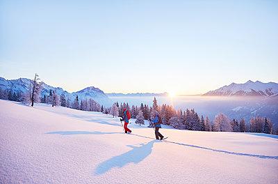 Austria, Tyrol, swshoe hikers at sunrise - p300m1587670 by Christian Vorhofer