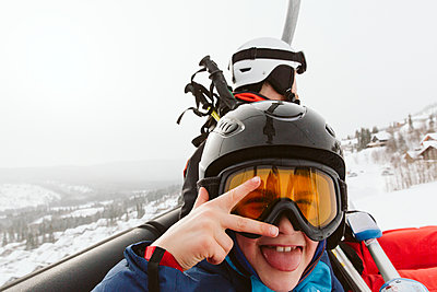 Boy and man on ski lift - p312m2080106 by Lina Arvidsson