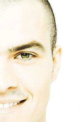 Young man smiling at camera - p62316389f by Alix Minde