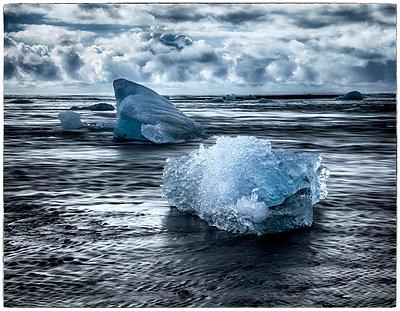 Ice blocks on shore - p1154m1110134 by Tom Hogan