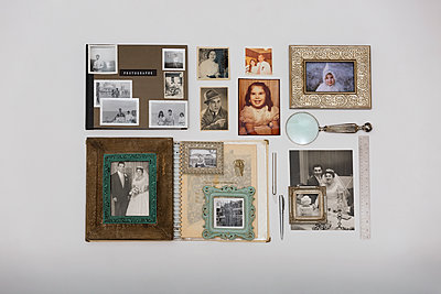 Overhead still life nostalgic family photos - p1192m1213099 by Hero Images