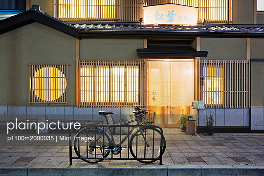 Bicycle Outside an Asian Restaurant - p1100m2090935 by Mint Images